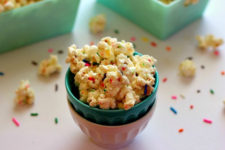 Filled with creamy white chocolate, yellow cake mix, and colorful sprinkles, you'll find a new reason to celebrate with this Cake Batter Popcorn. | Ideahacks.com