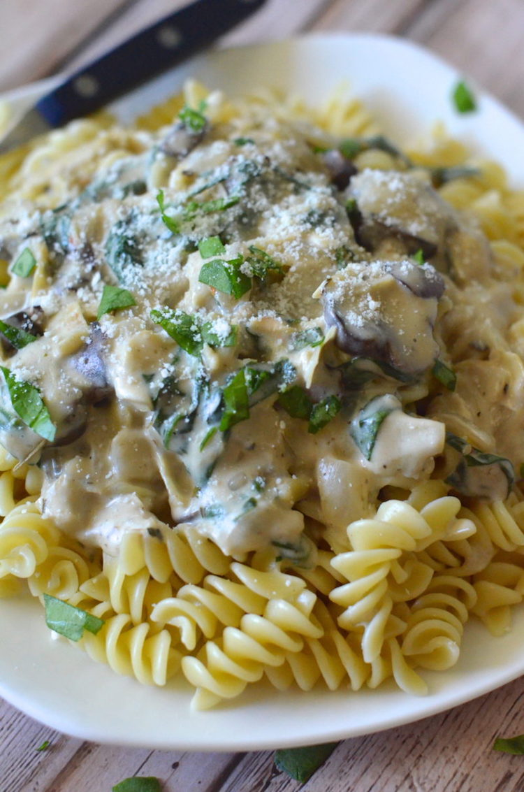 Chicken Pasta with Artichoke Spinach Cream Sauce - A bubbling pasta dish that oozes with cheese and flavor. | Ideahacks.com