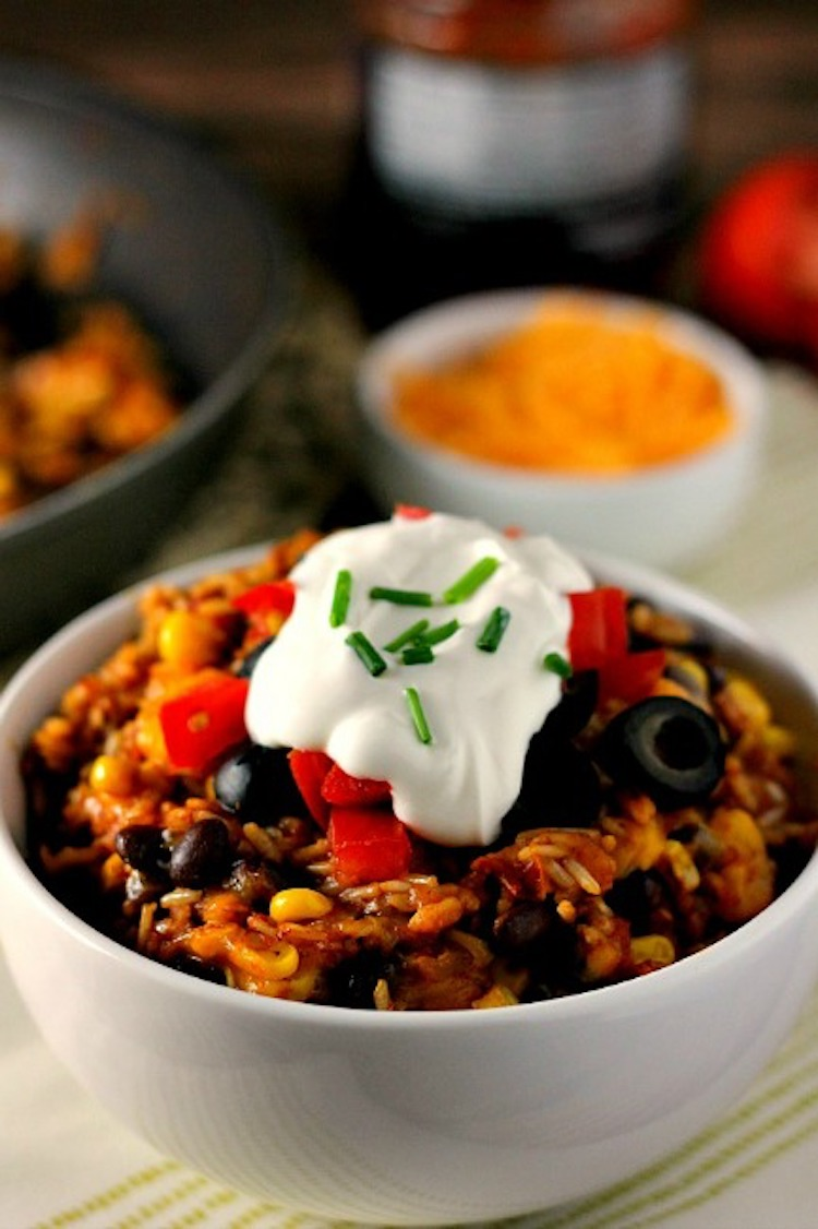 Made in one pan and ready in 30 minutes, this One Pan Zesty Burrito Bowl is filled with brown rice, black beans, fresh veggies, and cheese! Ideahacks.com