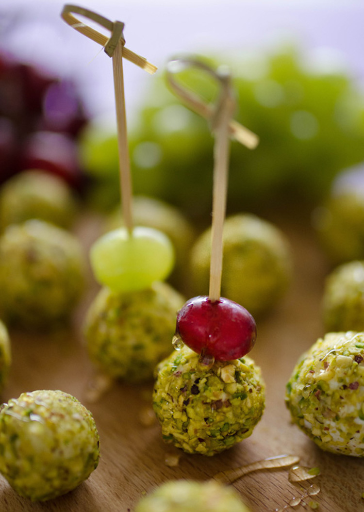Goat Cheese Wrapped Grape Bites - I wrapped grapes in goat cheese and rolled them in pistachios and goodness gracious grape balls of goat cheese were they good. | Ideahacks.com