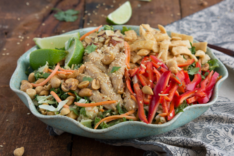 Asian Chicken Salad - This salad is filled with fresh ingredients, packed with protein, and has a dressing that is deliciously spicy. | Ideahacks.com