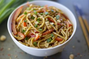 Spicy Asian Noodles with Peanut Sauce - Noodles covered in a delicious sweet and salty peanut sauce and are sprinkled with spicy red pepper flakes, sesame seeds for extra flavor, and chopped peanuts | Ideahacks.com