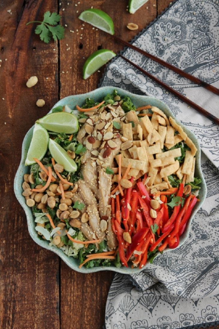 asian chicken salad with chopsticks