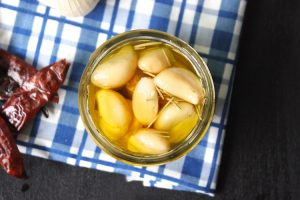 Garlic Confit - This recipe can be used to go on pizza, pasta, and mashed potatoes. It makes a great olive oil as well. | Ideahacks.com
