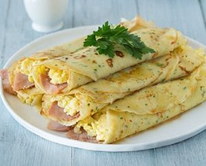 Herb Crepes with Eggs, Swiss, Ham and Browned Butter