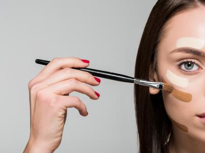 woman brushing her face
