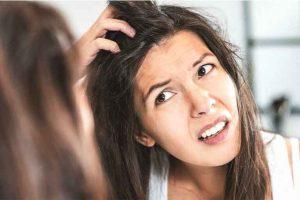 girl scratching her scalp