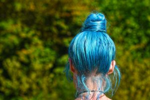 Girl's head with blue hair color