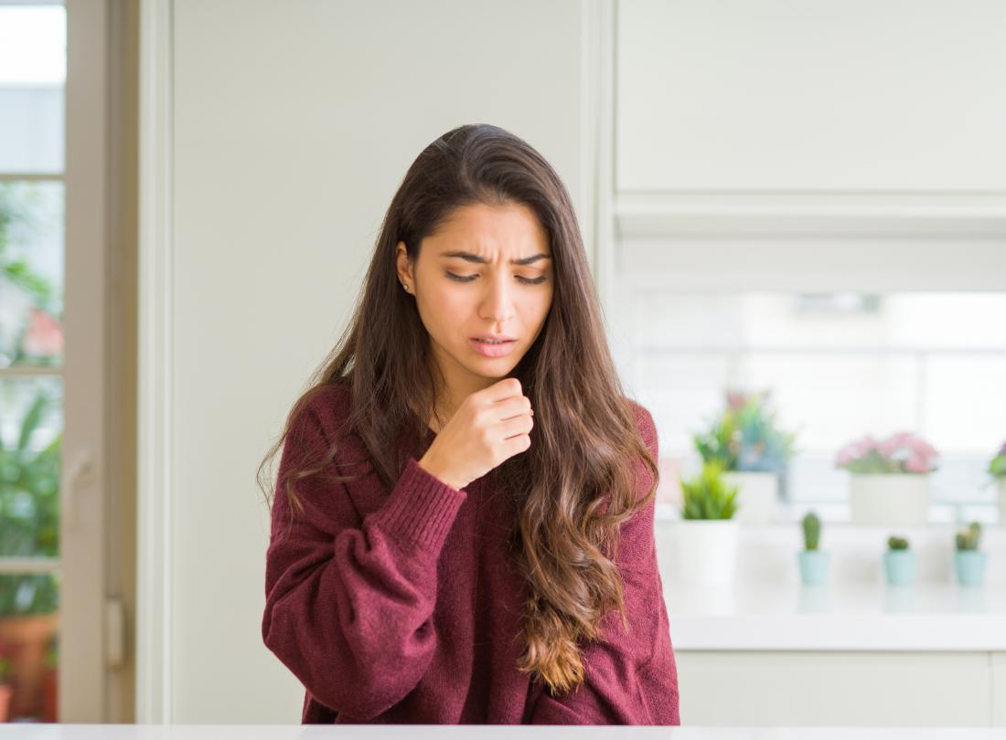 Woman Coughing due to Dry Cough