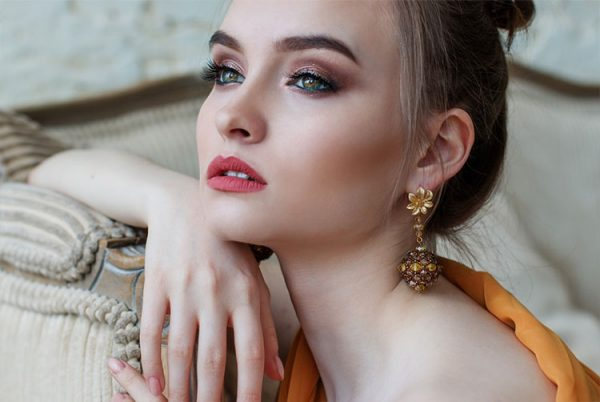 Portrait of beautiful woman model with fresh makeup