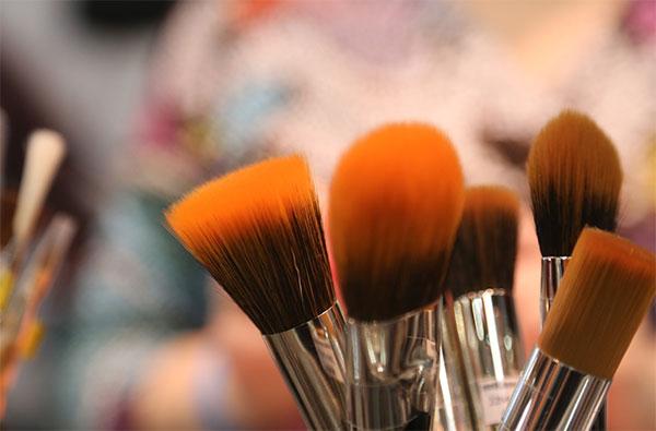 Orange makeup brushes