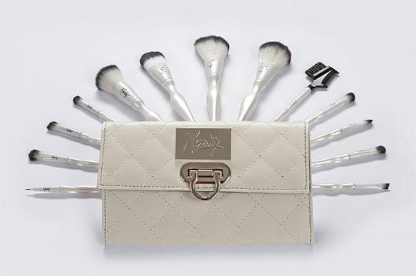 Set of white makeup brushes
