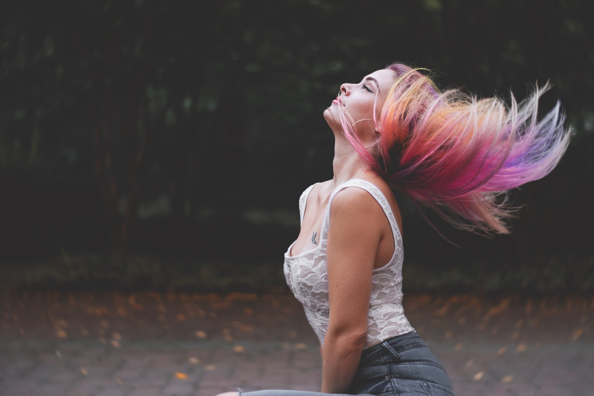 Girl's flying hair has a rainbow hair color