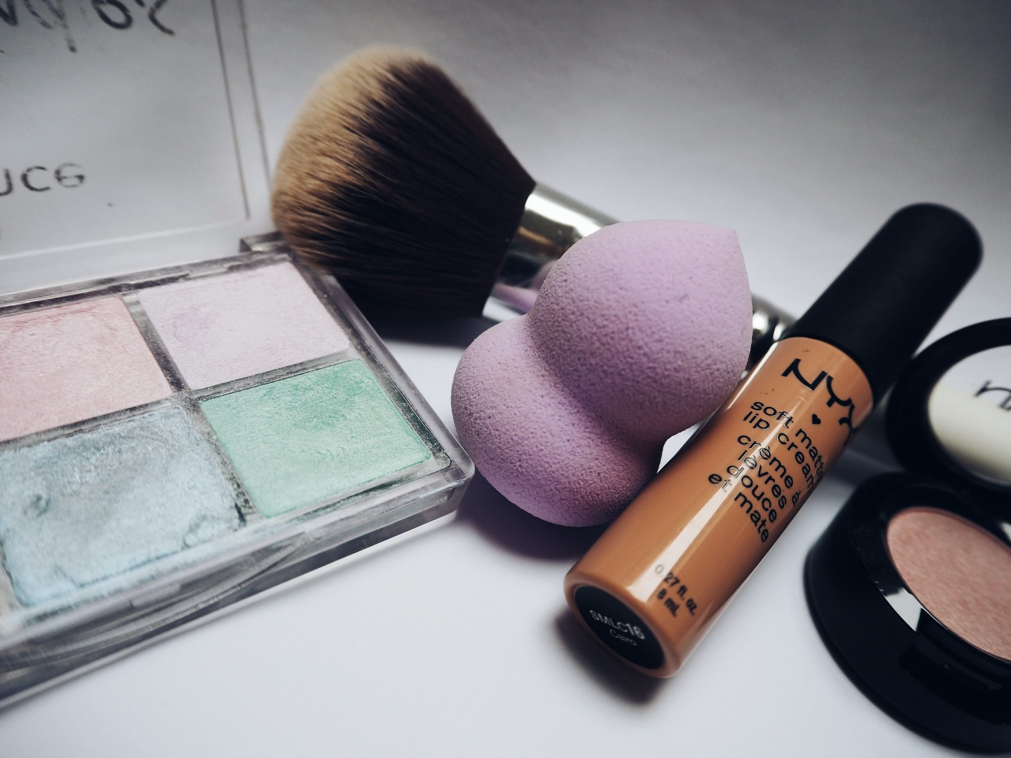 Cosmetics eyeshadows,foundation,lipstick and the best makeup sponge