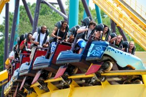 people riding on a roller coaster
