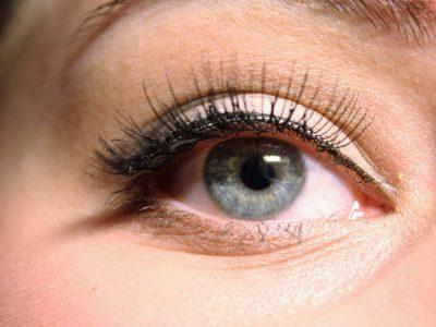 Woman's blue eyes wearing a false eye lashes