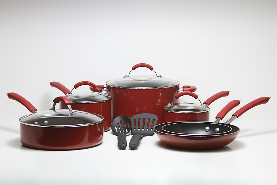 Red pots and pans on white table