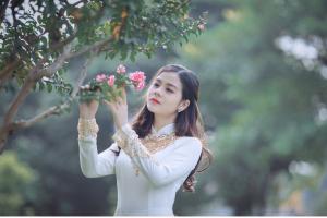sweet woman picking flowers