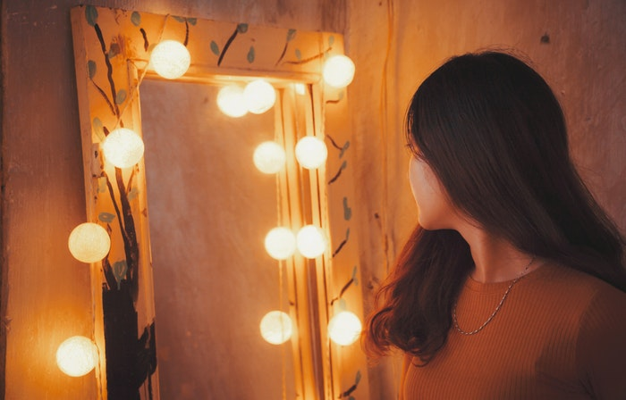 lady in front of vanity mirror