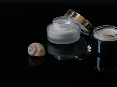 two face cream with an open lid