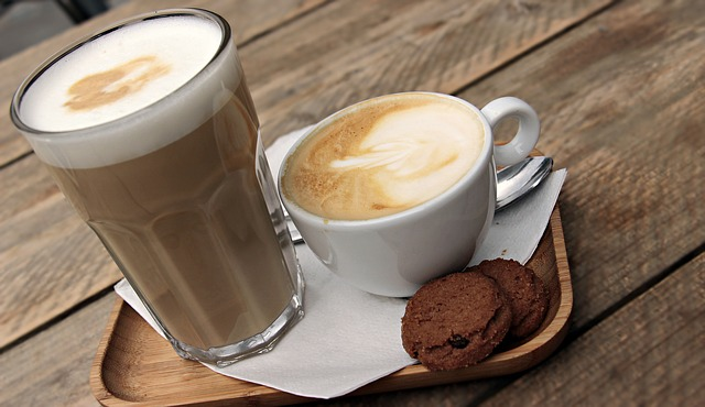 a glass of coffee smoothie and a cup of coffee