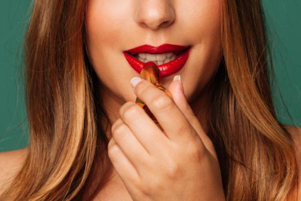 model holding lipstick