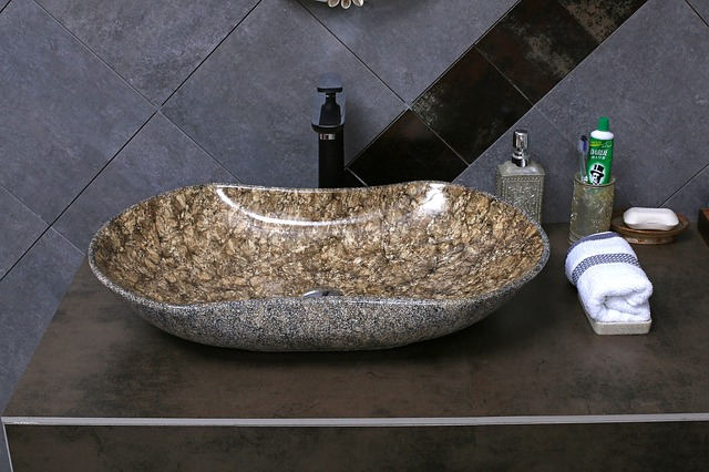 bathroom sink with towel and other toiletries