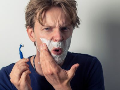 A man who cut himself shaving and needs a Styptic Pencil